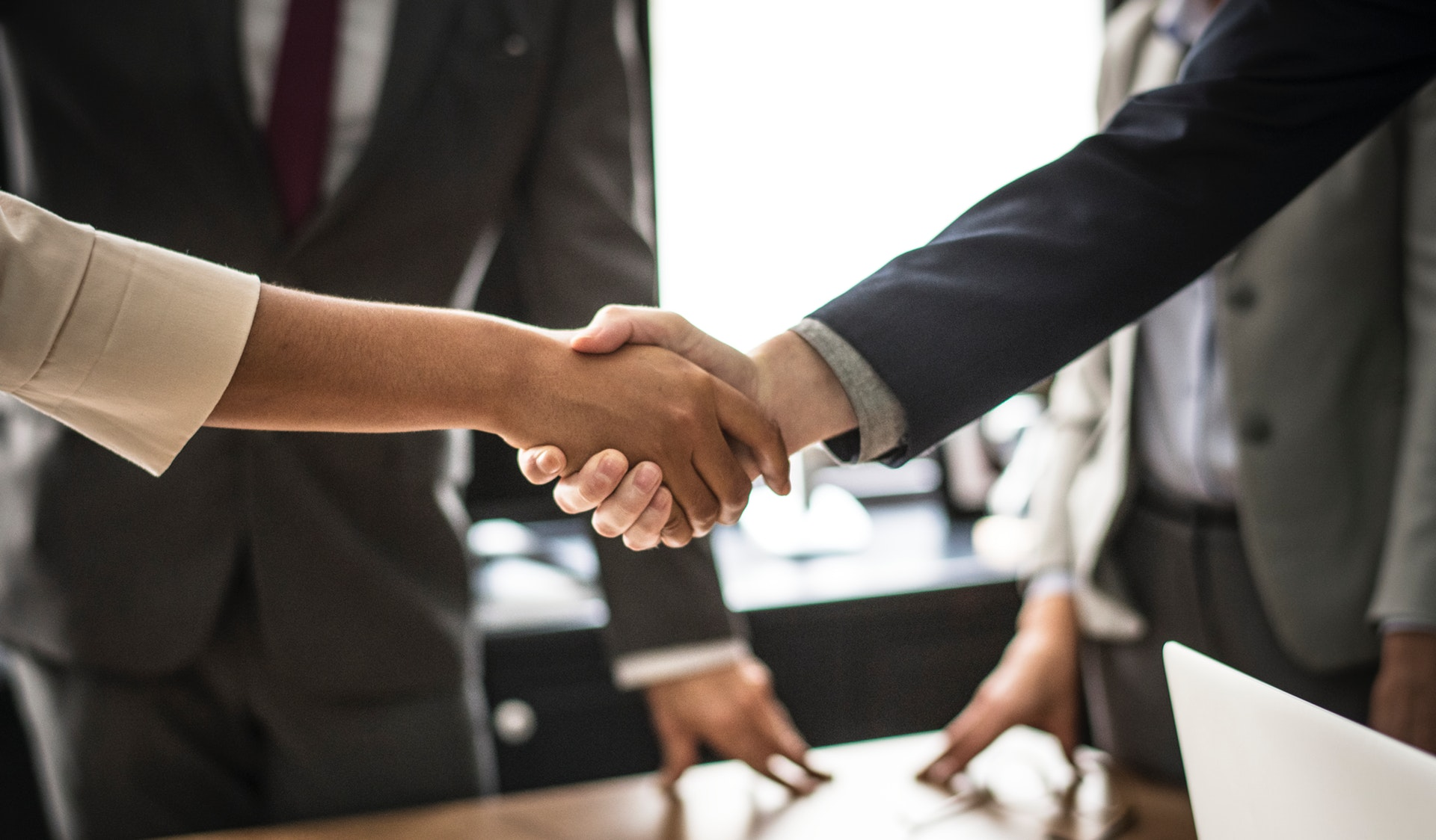 Business Managers handshake in office