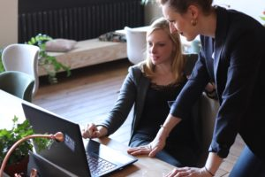 two female entrepreneurs working on a laptop