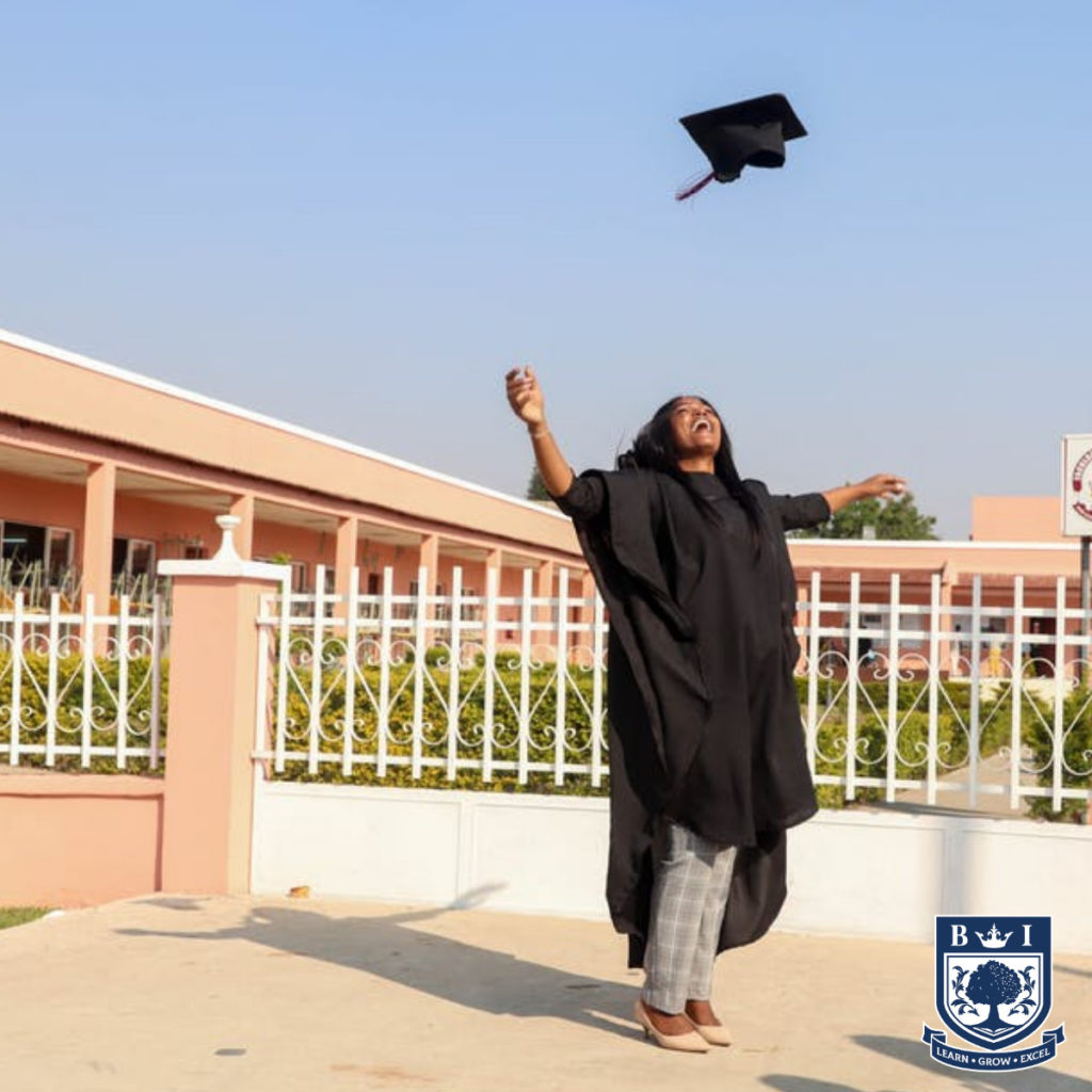 A woman celebrating getting her National Diploma with the Bellview logo in the corner